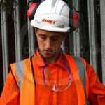 Railworker wearing Orange Hi-vis Bizflame Boilersuit from Portwest