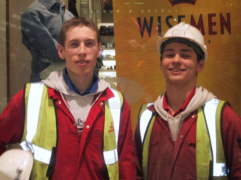 Young guys in red coveralls at Canary Wharf 2