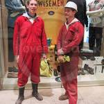 Young guys in red coveralls at Canary Wharf