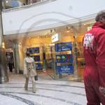 builders in red coveralls at Canary Wharf