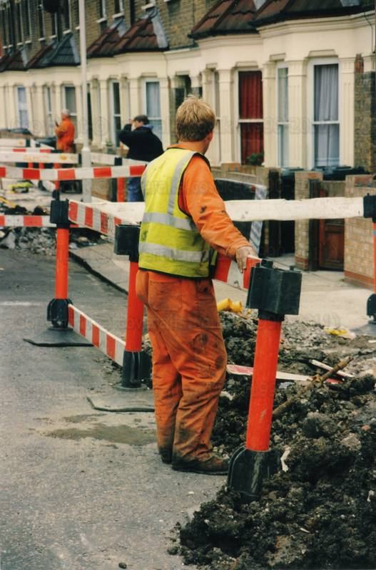 Picture of Road digger, wearing orange coveralls and hi-vis fluorescent vest