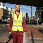 Road Sweeper wearing a Maroon Portwest boilersuit/coverall and yellow hi-vis waistcoat