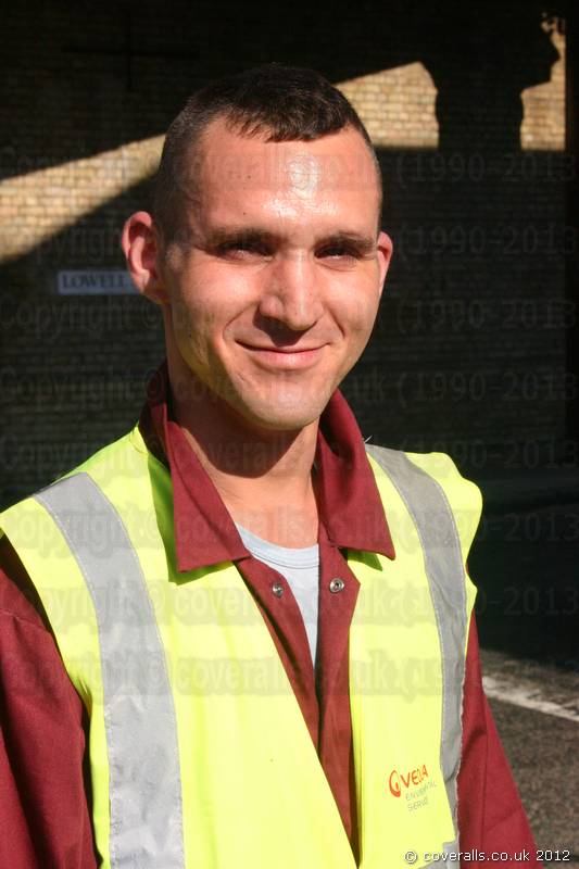 Picture of Road Sweeper wearing a Maroon Portwest boilersuit/coverall and yellow hi-vis waistcoat