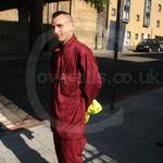 Road Sweeper wearing a Maroon Portwest boilersuit/coverall