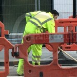 Road Worker Wearing Hi-vis Yellow Boilersuit
