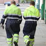 Scaffolding Fitters wearing yellow/blue hi-vis coveralls