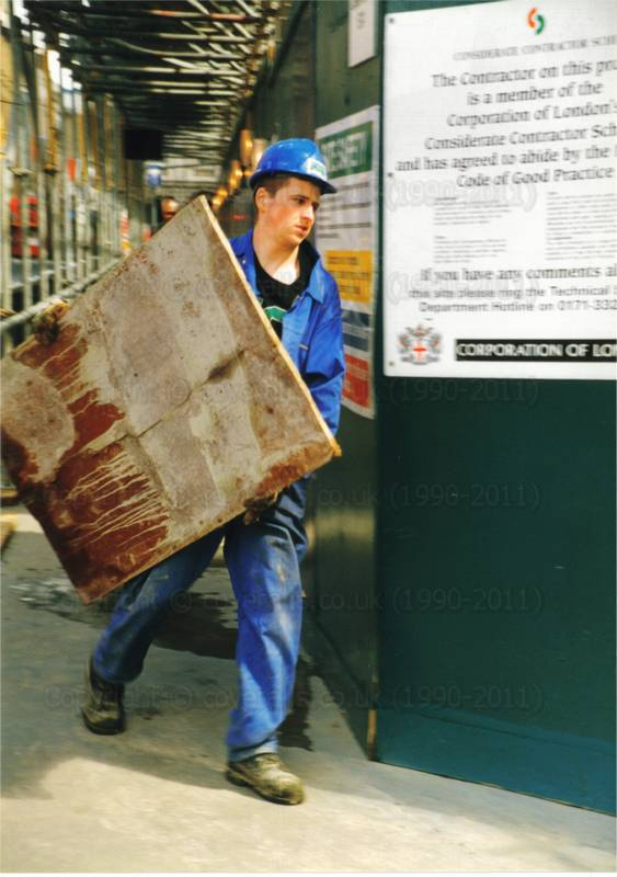Student on Building Site, wearing blue coveralls and hardhat 1