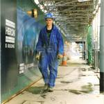 Student on Building Site, wearing blue coveralls and hardhat