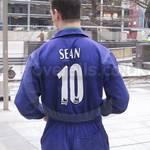 """SEAN 10"" was silk-screened onto on the back of his blue coverall"