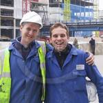 Two mates wearing blue coveralls working at Canary Wharf