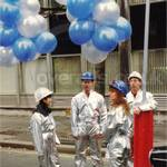 Boy wearing silver coverall