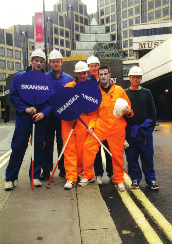 Picture of Guys wearing coveralls on Skanska Float at Lord Mayor's Show
