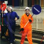 Guys wearing coveralls on Skanska Float at Lord Mayor's Show