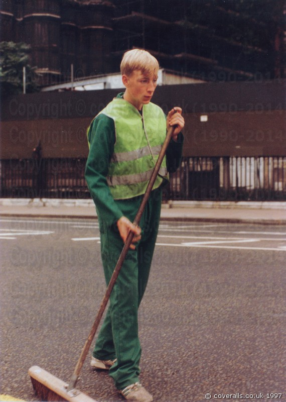 Road Sweeper wearing green coverall and green hi-vis waistcoat 1
