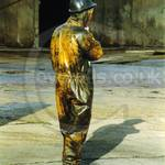 Power washers wearing dirty yellow protective PVC coveralls