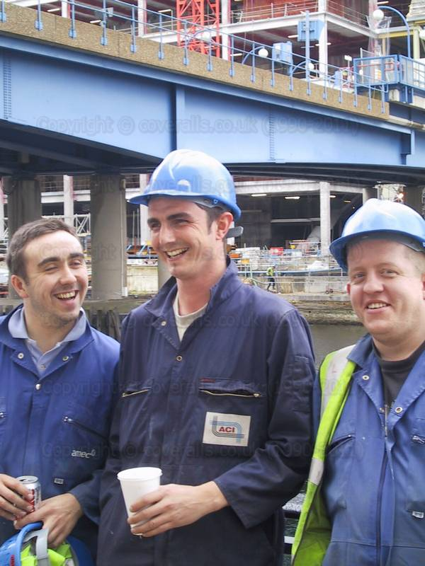 Three Lads in Blue Overalls working in Canary Wharf. Three Lads in Blue Overalls 10