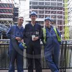 Three Lads in Blue Overalls working in Canary Wharf
