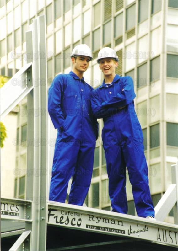 Guys wearing blue coveralls and sliver hardhats on Canary Wharf Float at Lord Mayor's Show supplied by the Tommy Tucker Agency. Guys wearing blue coveralls and sliver hardhats on Canary Wharf Float at Lord Mayor's Show 1