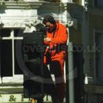 Traffic Light engineer wearing orange overalls