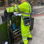 Traffic Light Engineer Wearing Hi-vis Yellow Super Touch Coveralls 3