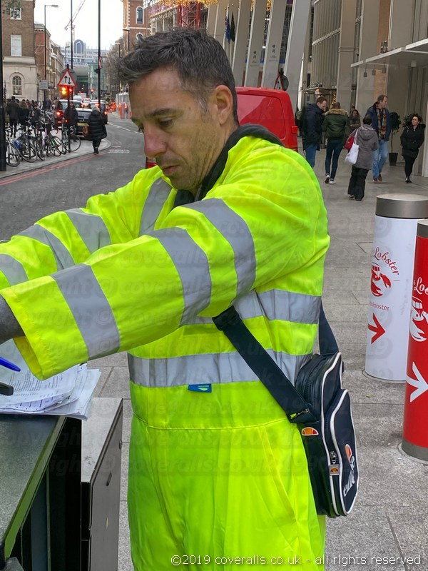 Traffic light engineer working on a street traffic-light control unit. Traffic Light Engineer Wearing Hi-vis Yellow Super Touch Coveralls 6