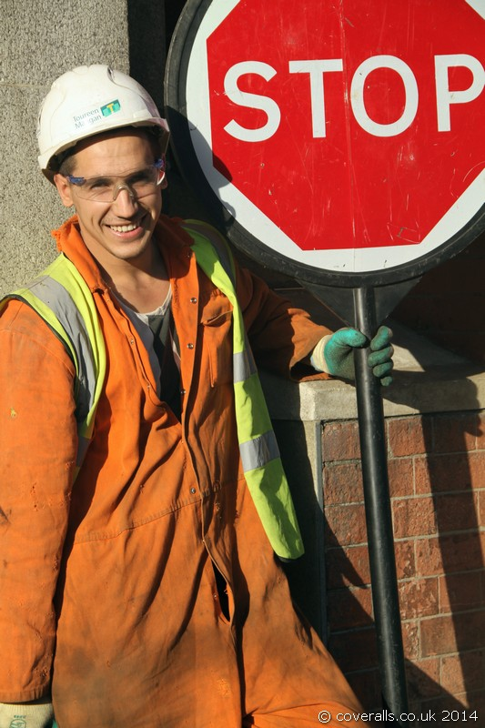 Two young workmen with traffic stop go boards. Traffic Control Stop Go Board Workmen 11
