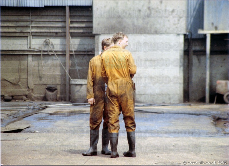 twash5.jpg - picture of Guys washing trucks wearing dirty brown overalls