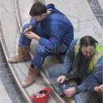 Young guy wearing blue coveralls at Canary Wharf