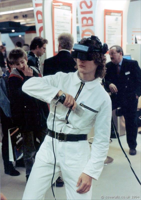 Guy wearing white KLM zip overall and Virtual reality headset demonstrating VR at Cebit Hannover Messe 1994. Guy wearing white KLM zip overall demonstrating VR at Cebit Hannover Messe 1994 1