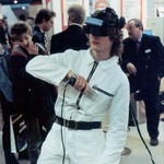 Guy wearing white KLM zip overall demonstrating VR at Cebit Hannover Messe 1994