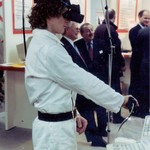 Guy wearing white KLM zip overall and Virtual reality headset demonstrating VR at Cebit Hannover Messe 1994