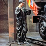 Truck Washers, wearing dirty green waterproof PVC coveralls