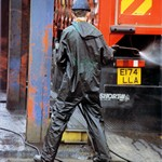 Truck Washers, wearing dirty green waterproof PVC coveralls 2