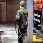 Truck Washers, wearing dirty green waterproof PVC coveralls 7