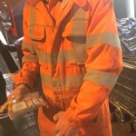 Young water worker lad wearing Orange Hi-vis coveralls