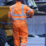 Water workers reworking the water mains wearing Pulsar ARC orange hi-vis Boilersuits