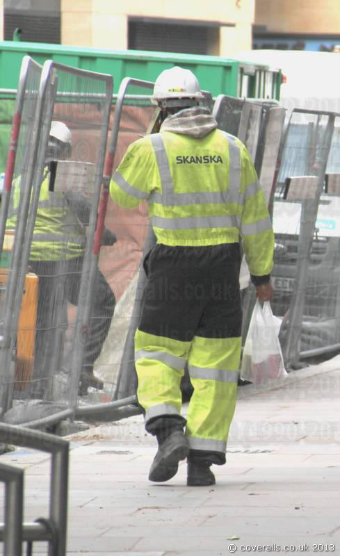 Water Engineer Wearing a new Yellow Grey Hi-vis Phoenix Flame Resistant Coverall. Water Engineer Wearing Yellow Grey Hi-vis Flame Retardant Coverall 1