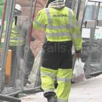 Water Engineer Wearing Yellow Grey Hi-vis Flame Retardant Coverall