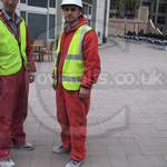 Guys wearing red coveralls, one nylon one poly-cotton at Canary Wharf