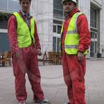 Guys wearing red coveralls, one nylon one poly-cotton at Canary Wharf 3