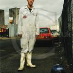 Guy in Docklands, wearing white coveralls