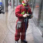 Window cleaner wearing a waterproof coverall 1