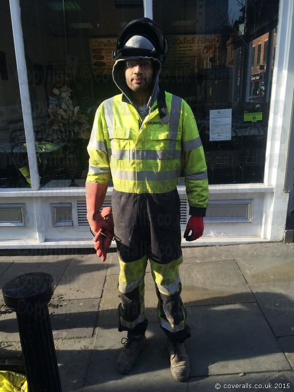 Workman Wearing a Yellow Grey Hi-vis Phoenix-fr Flame Resistant Coverall. Workman Wearing Hi-vis Yellow Grey Phoenix-fr Coverall 2