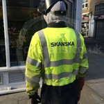 Workman Wearing a Yellow Grey Hi-vis Phoenix-fr Flame Resistant Coverall