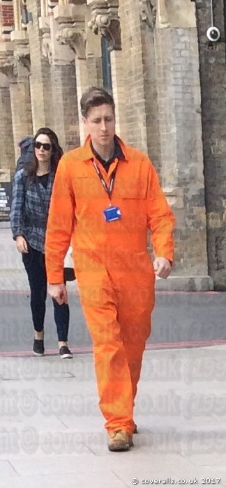 Workmen wearing orange coveralls. Workmen-orange-coveralls 51