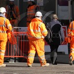 Workmen working on the crossrail construction project in London in rail spec hi-vis coveralls