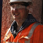 Workmen Wearing Orange Hi-vis Rail Spec Hercules Apollo Coveralls