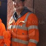 Workman working on the crossrail construction project in London in wearing orange Hercules coveralls