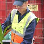 Young Blonde Road Sweeper Wearing Blue Boilersuit