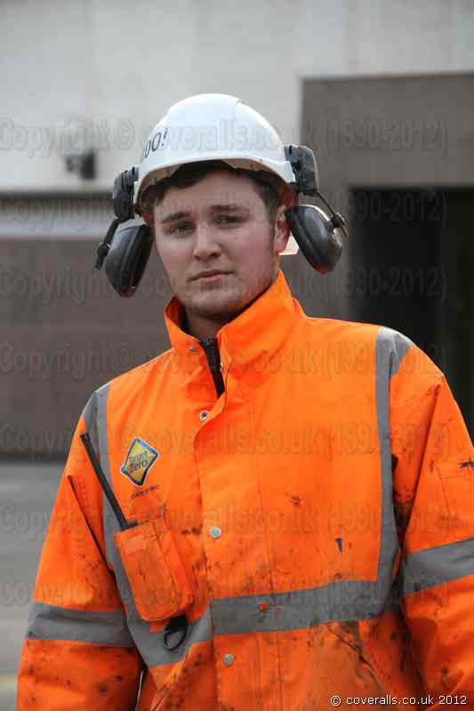 Young Construction Worker wearing Hi-Vis rail specification workwear. Young Construction Worker in Hi-Vis Gear 8